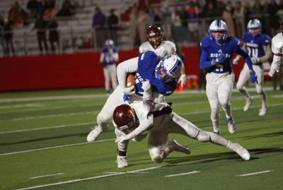 Sugar-Salem running back Logan Cutler takes a Teton defender's tackle.
