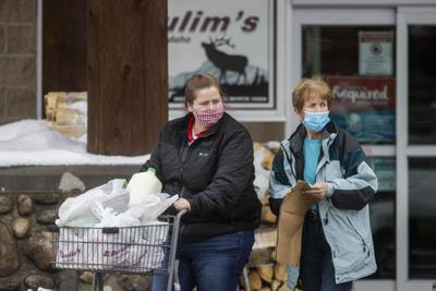 Shoppers wear masks at the local grocery store in Driggs, Idaho