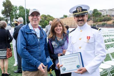 Nelson & parents Grad Pic 2021.jpg