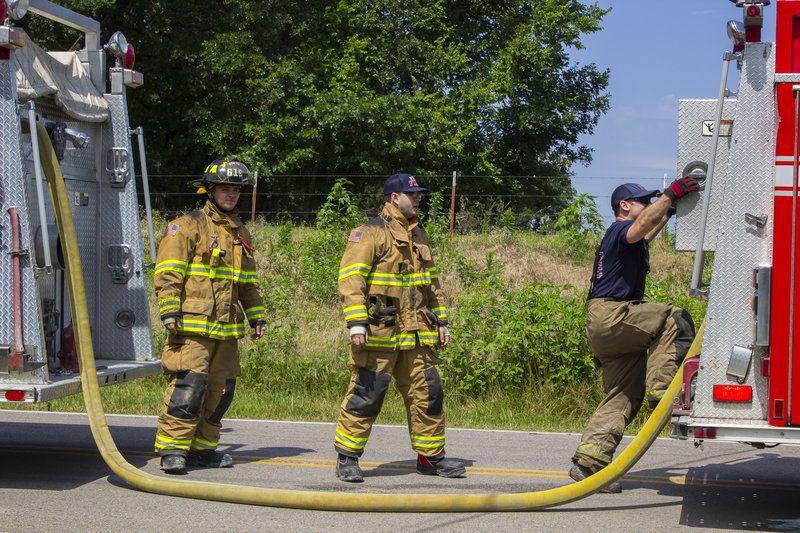 Local firefighters fight blaze in summer heat