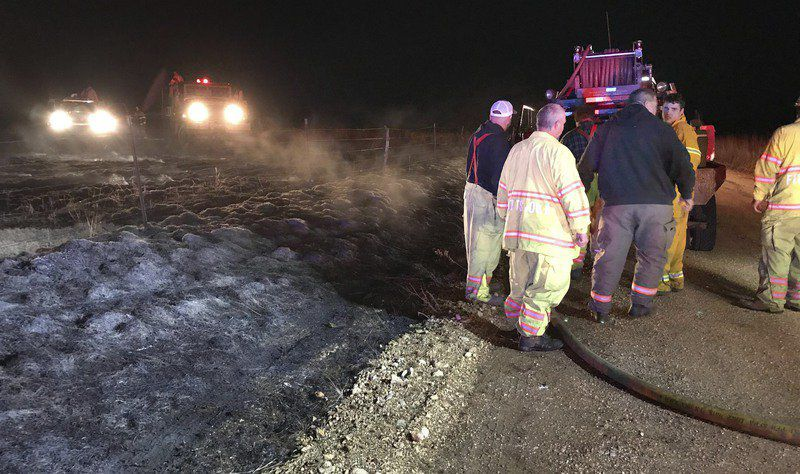 Fire crews chase large grass fire Tuesday