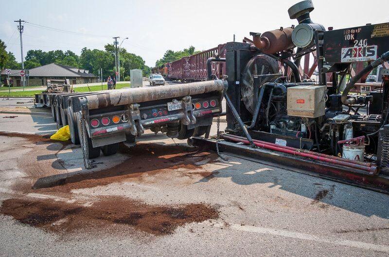 Train collides with semi at Crazy Corner; traffic tangled