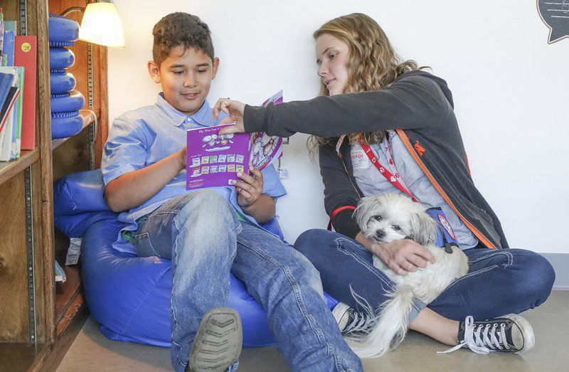 Therapy dogs help students relax and read
