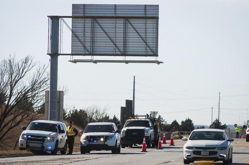 Sand truck rollover blocks J.A. Richardson Loop exit