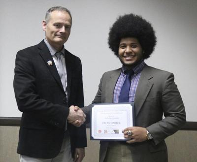 Barber receives two scholarships