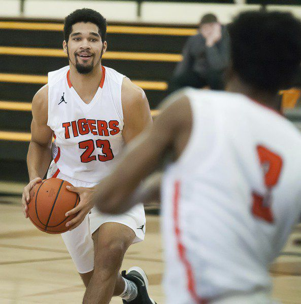 Tigers hang on after late miss by Southwestern