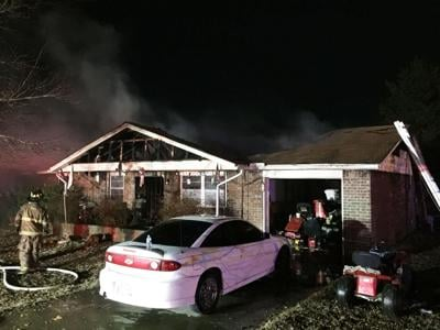 Father, son die in Latta house fire