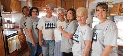 Sisters Hand- in-Hand helps Macomb resident