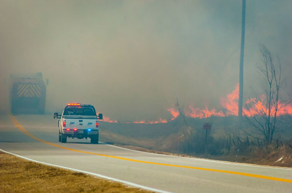 Fire jumps highway