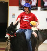 Locals try their skills at Donkey Basketball!