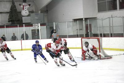 Boys hockey takes two of three