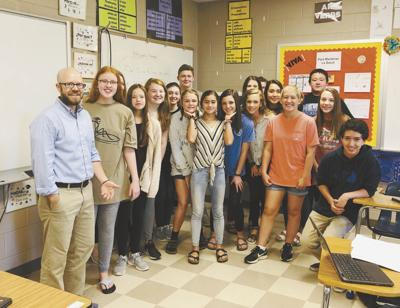 Jonathan Sanford, left, with one of his classes at Arab High School