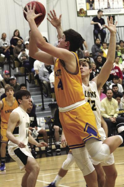 Arab's Brooks Malone takes it to the basket