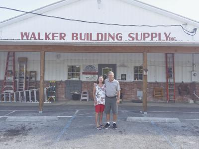 Mary and Harry Walker outside Walker Building Supply