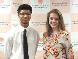 Health System Auxiliaries present scholarships to local graduates image 2