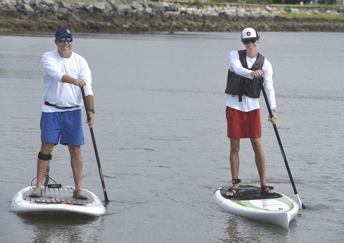 061519_akridge and son paddleboarding