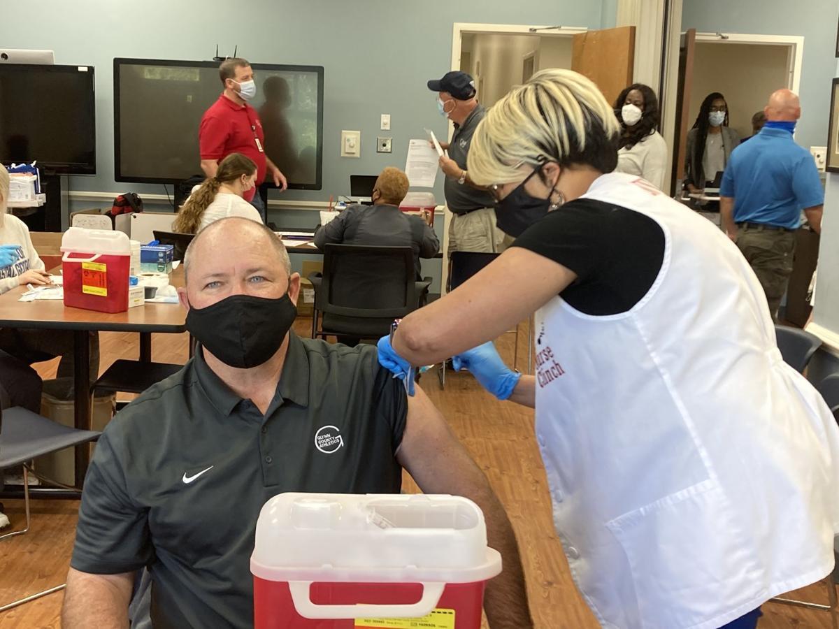 School superintendent receives vaccine