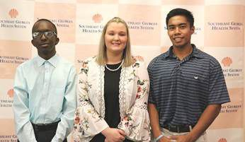 Health System Auxiliaries present scholarships to local graduates