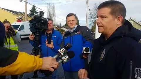 Scappoose Police Chief Norm Miller takes questions about a Scappoose bank robbery