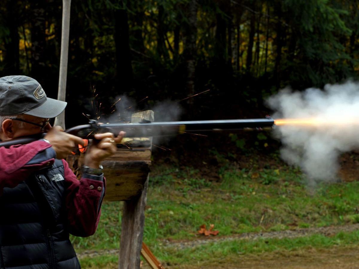 Muzzle loader rifle fire