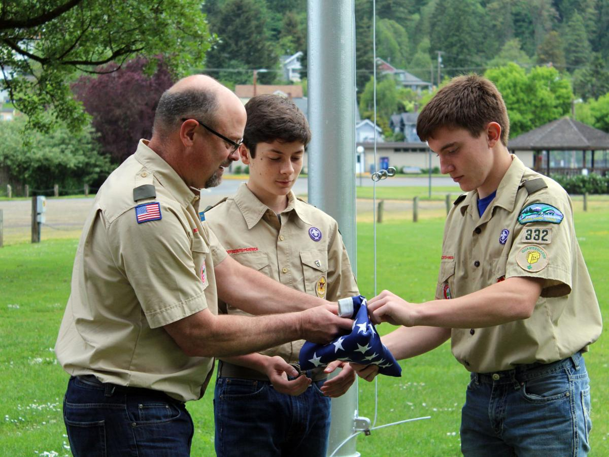 Scout repairs flagpole