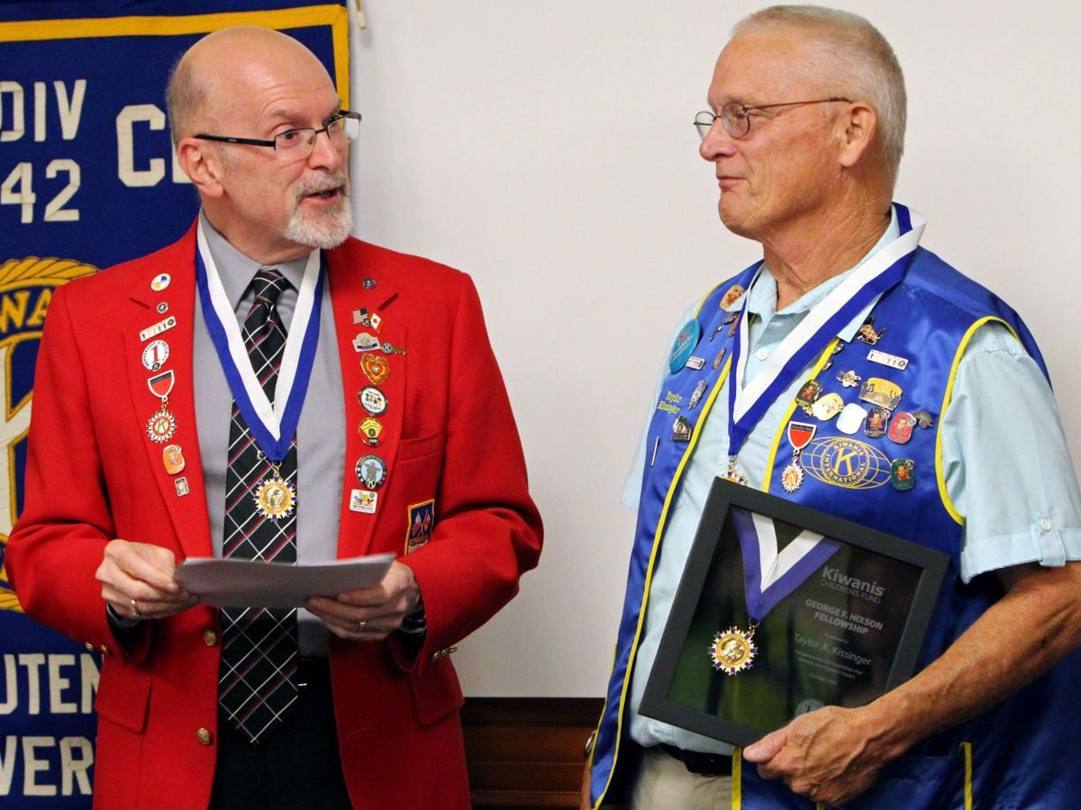 Kiwanis award Hixon to Kissinger