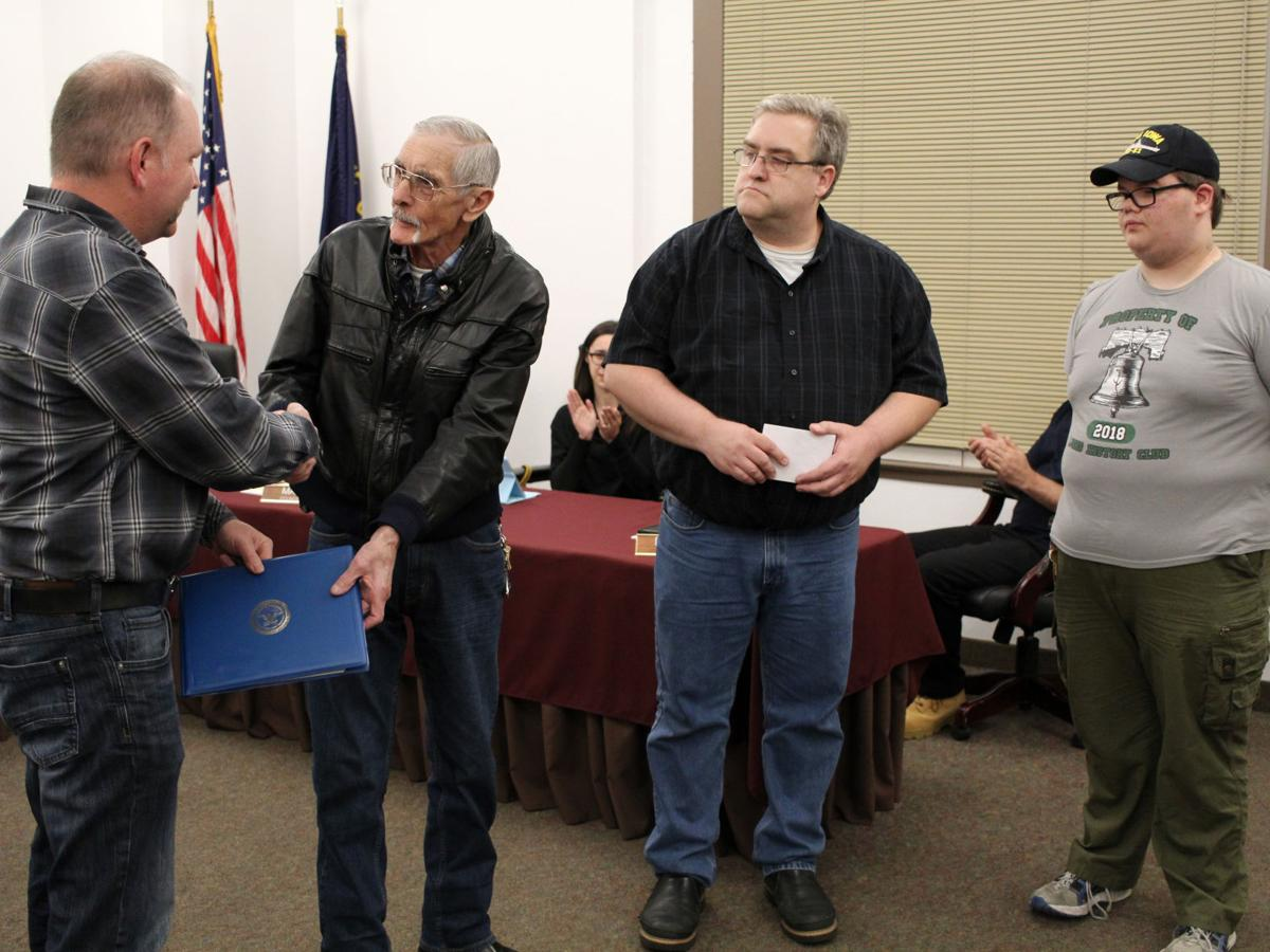 Owen honored at city council