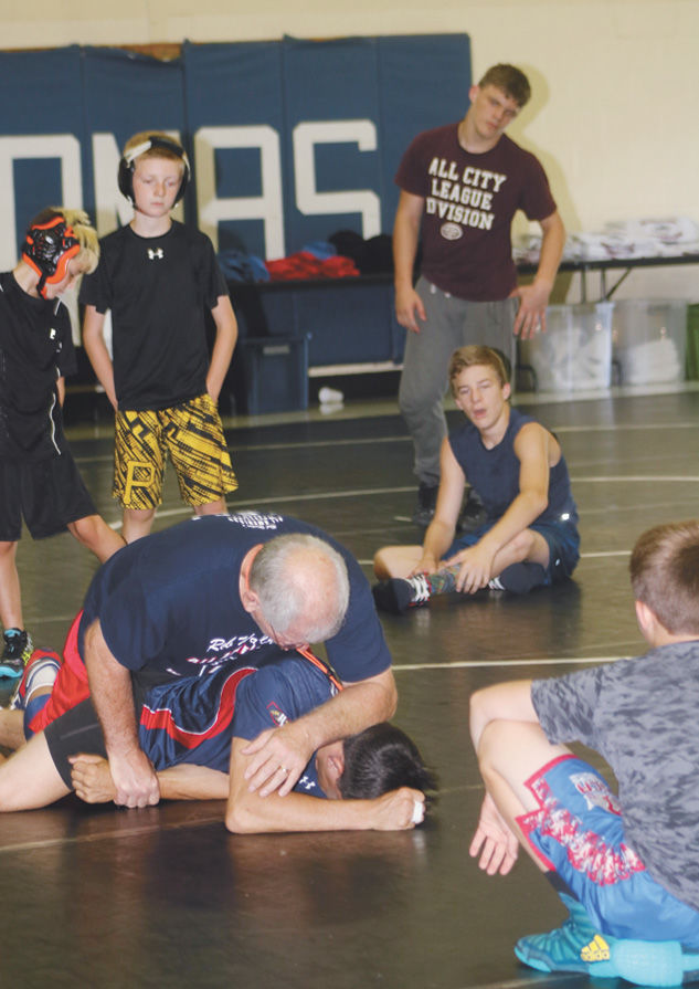 Rob Waller demonstrates a mat move at Thursday's session.