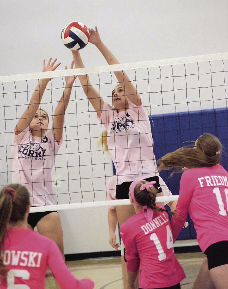 Bugbee and Ciara Davis (right) blocking at the net.