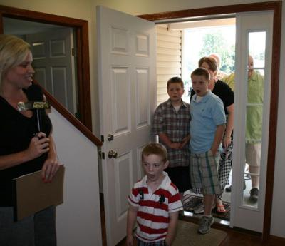 Reynolds family tours new home