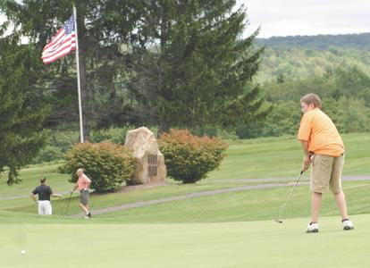 Corry splits in home golf action