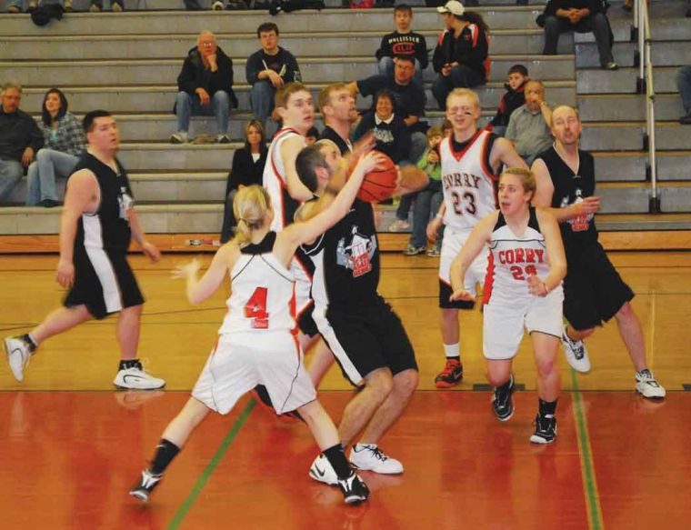 Teachers stuff students in basketball game fundraiser