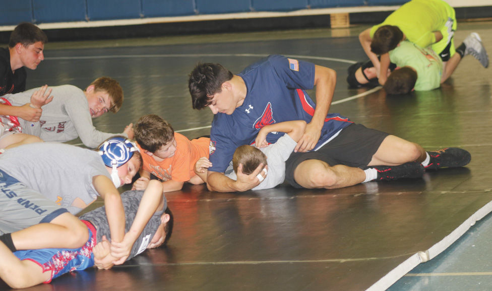 Mike DePalma (Kent State) puts a move on Van Ward.