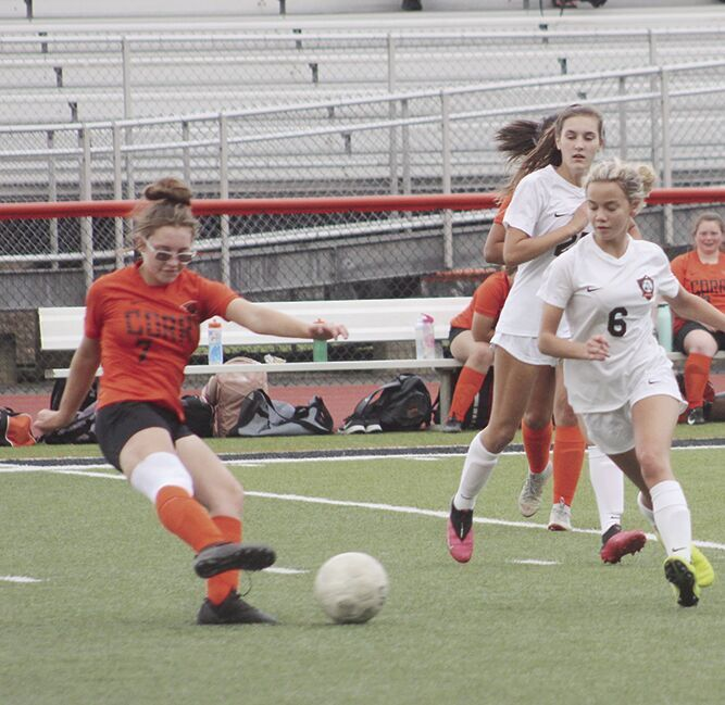 Emily Geer clears the ball.