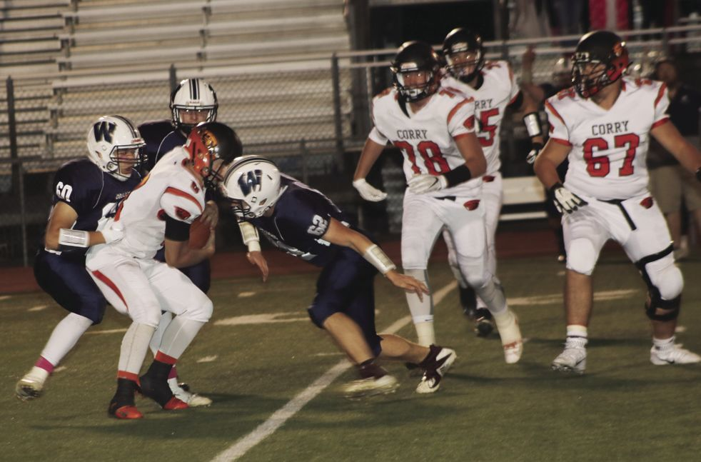 Beaver quarterback Nate Lesher gets sacked in the first quarter.