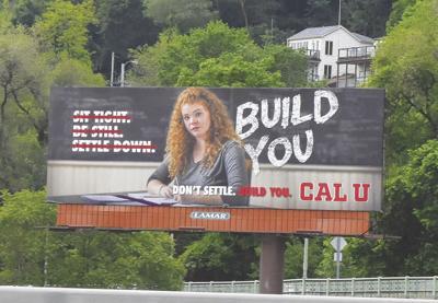 Corry grad on billboard