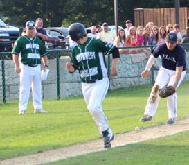 Corry's Liam Cragg slides safely into third base.