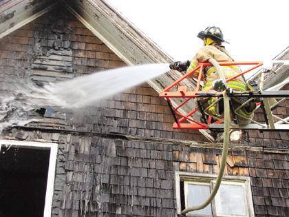 Outside burning sparks Northwest Street house fire