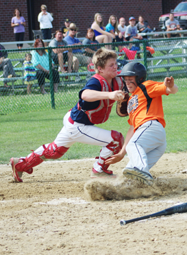 Bailey Volk avoids a tag by FLAG catcher Noah Coffman.