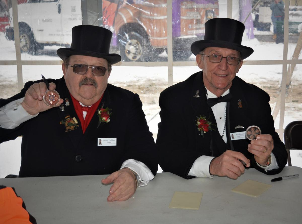 Inner Circle veterans with coins