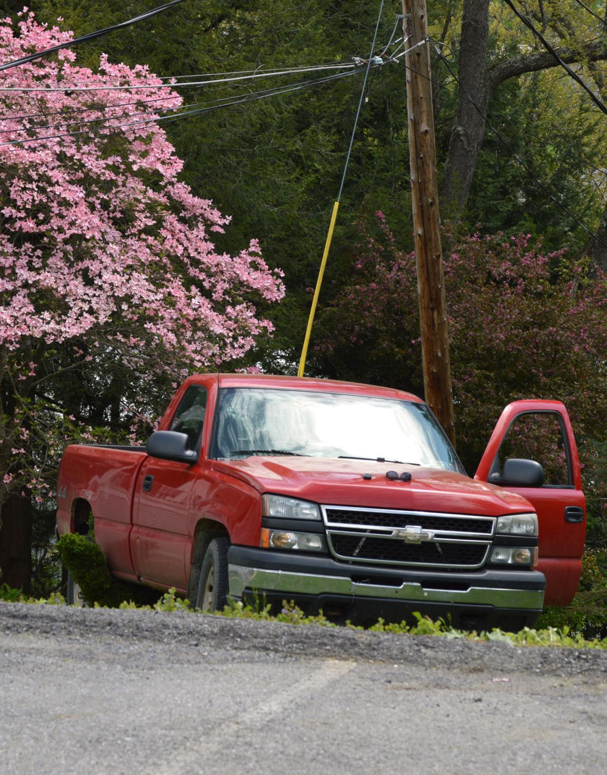 Truck goes down embankment near parking lot