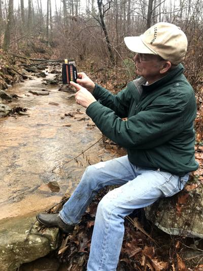 Pete Dalby checking water pH level