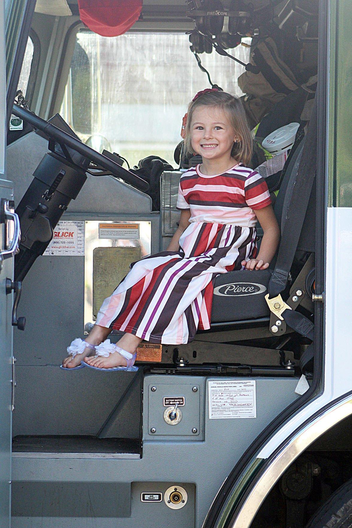 Girl in fire truck