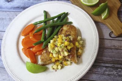 Serve spicy sauteed fish with pineapple mango salsa