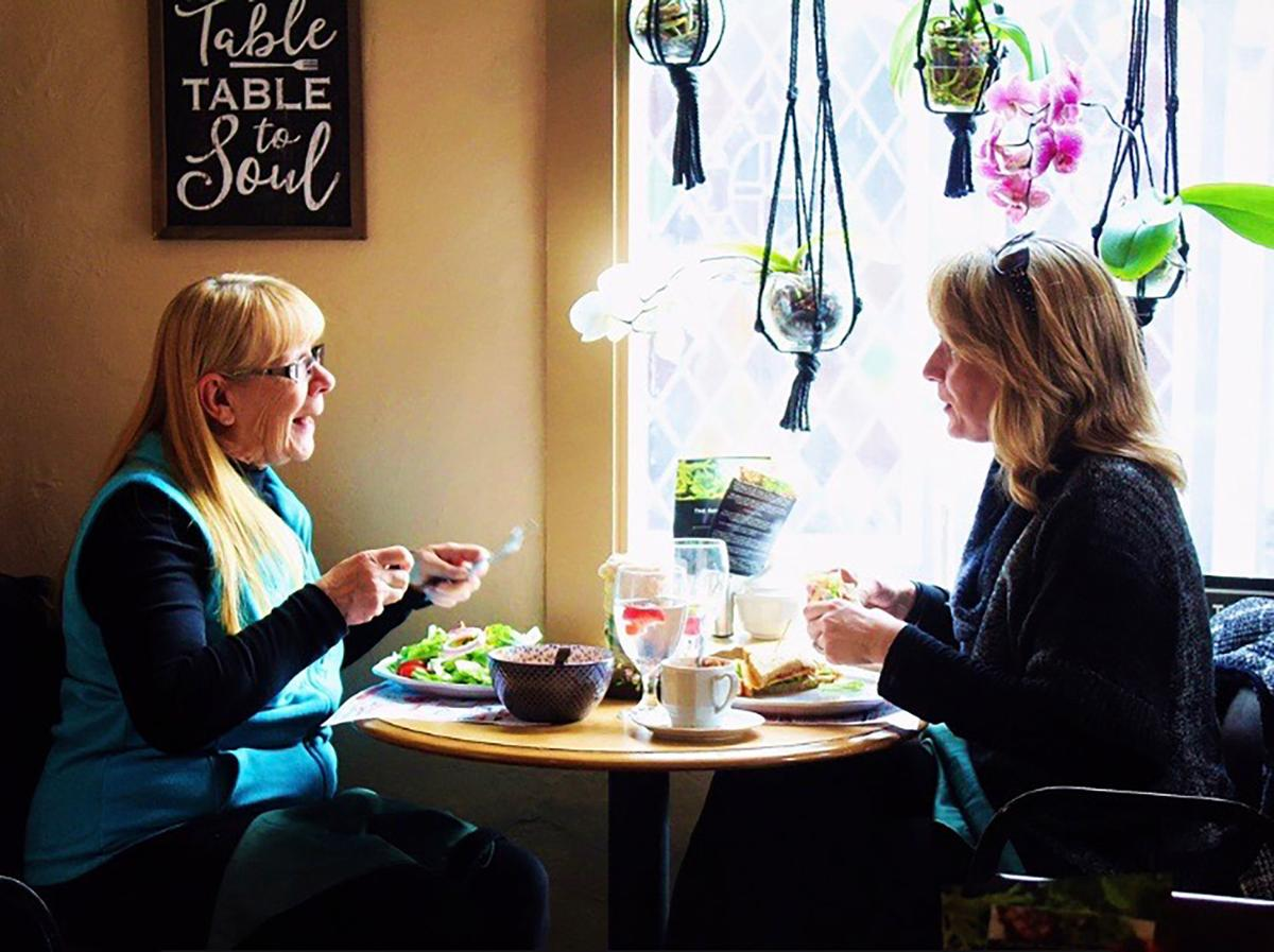 Mother-daughter enjoy lunch at cafe