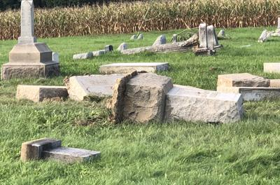 Monuments, tombstones toppled as cornstalks left standing