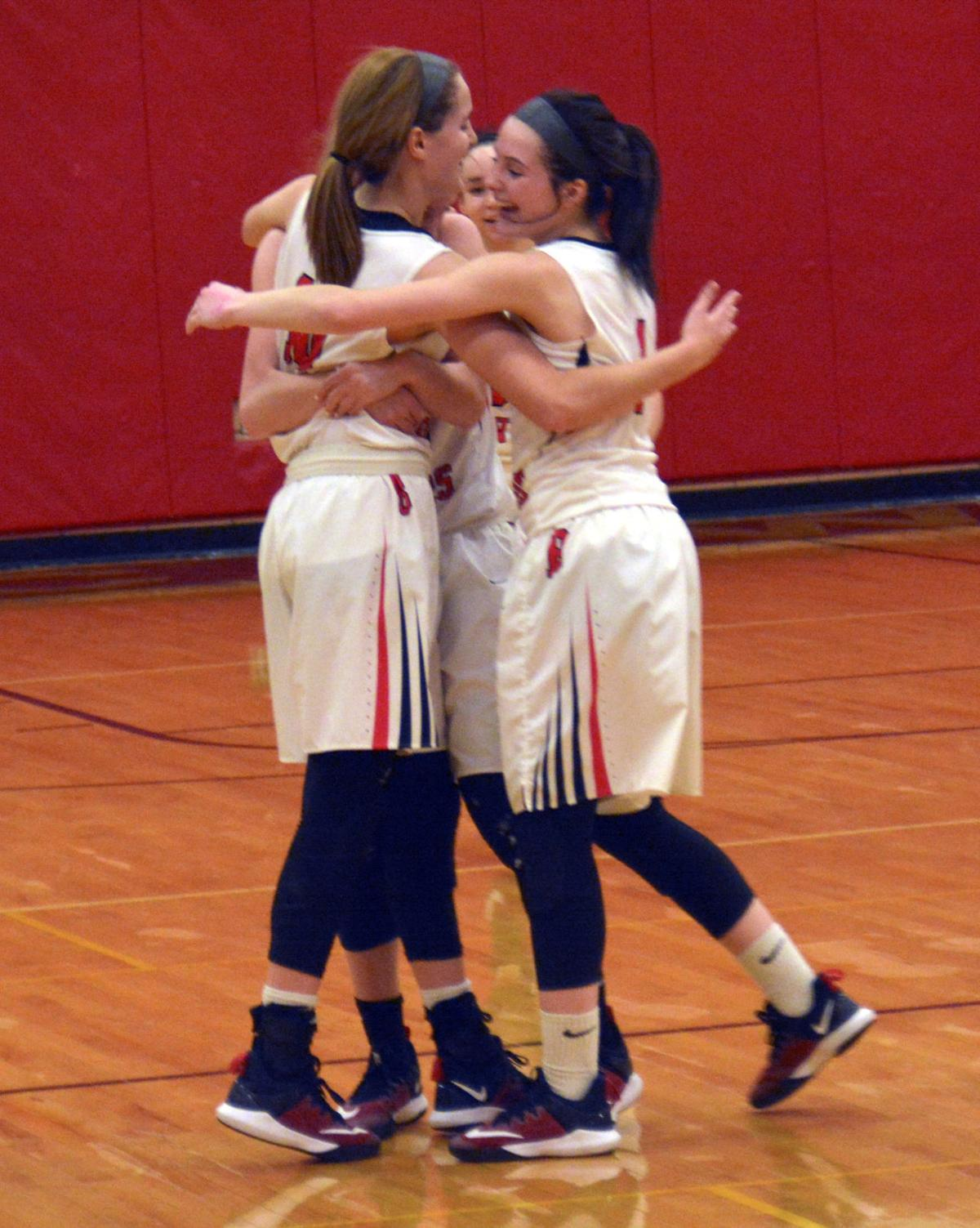 L. Lindemuth celebrates with teammates