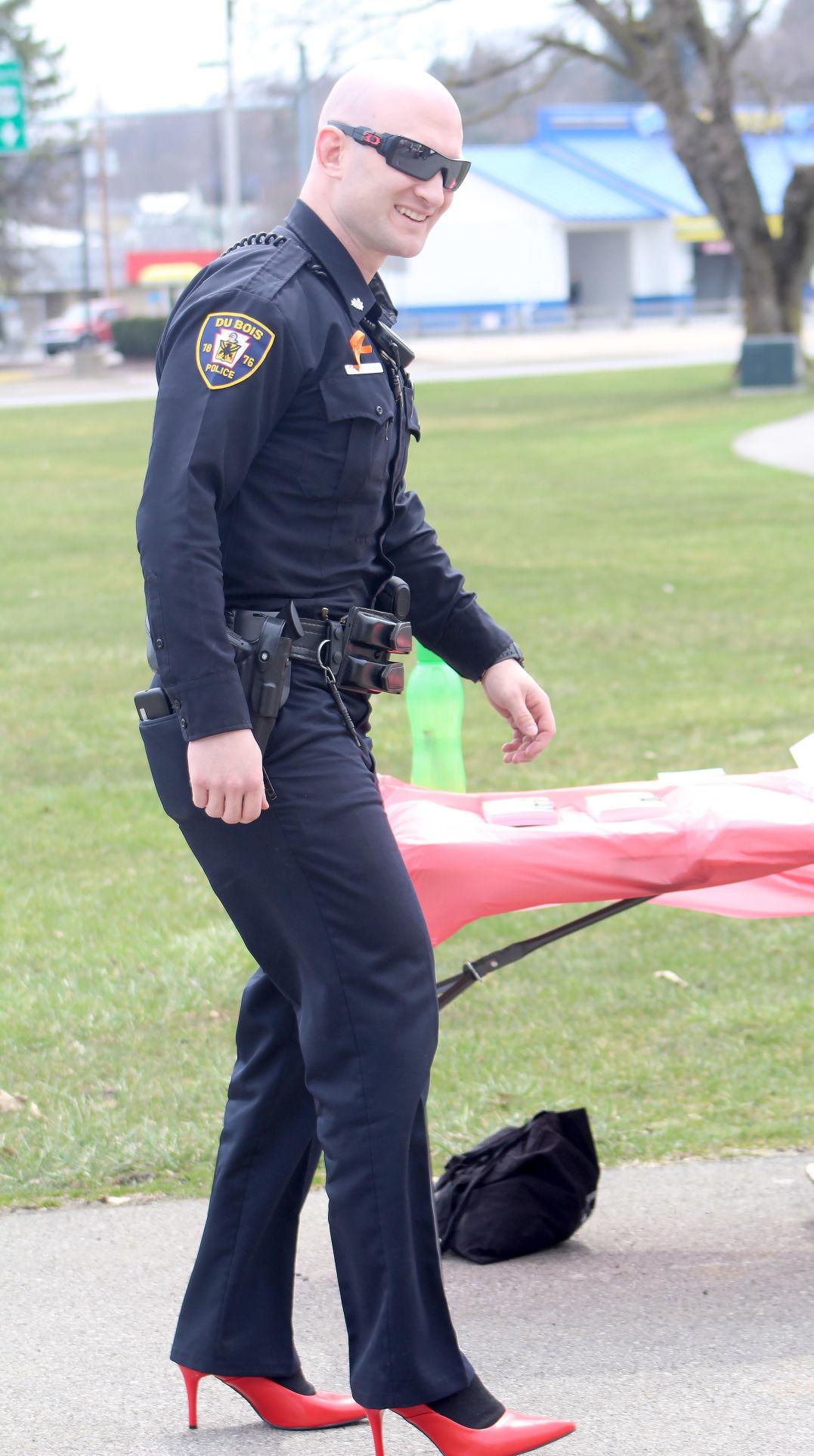Officer Lance Thompson wear red high heels