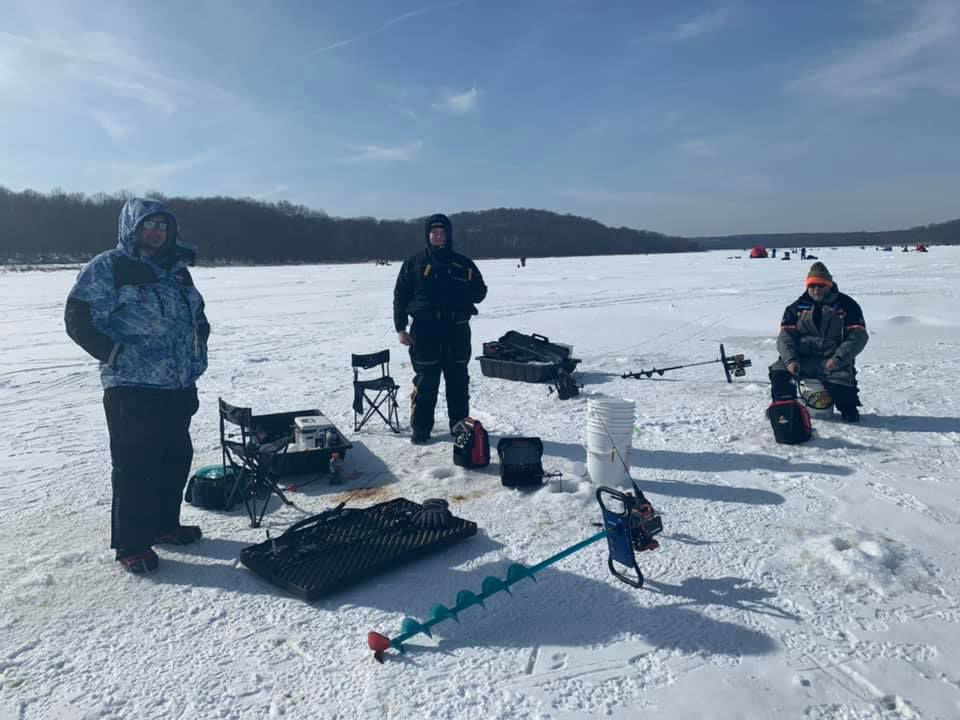 Ice fishing on a snow-covered lake