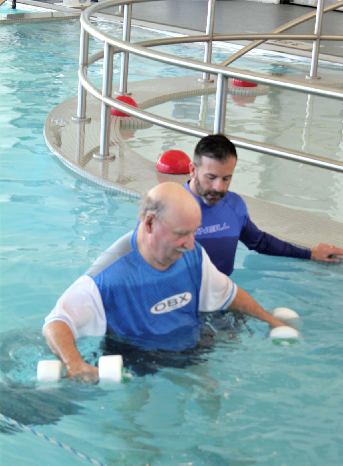 Working with aquatic dumbbells